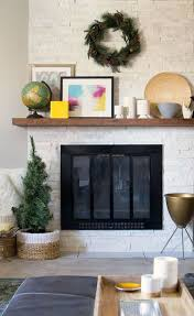 a modern rustic fireplace surround using ledger stone