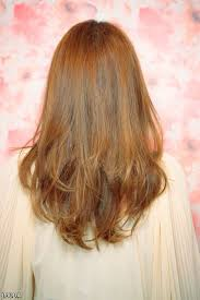 back of hairstyle cut with layers and ushape cut in back haircut layered medium back view