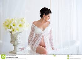 beautiful pregnant in light white lace negligee in the bathroom