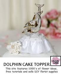glass wedding cake toppers dolphin wedding cake toppers