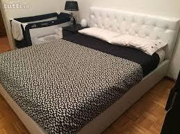 vendo materasso vendo letto contenitore con materasso e due comodini in ticino