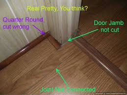 bad laminate installation the joints are not even cut at quarter round
