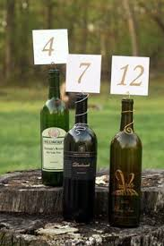 gold wine bottle table numbers wedding reception painted wine bottle table numbers decor