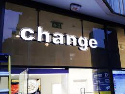 the shop bureau de change lettering shop front fascia signs