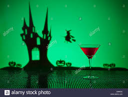 halloween haunted house witch and a cosmopolitan cocktail stock