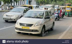indian car on road cars and in the foreground a taxi in the indian capital new delhi