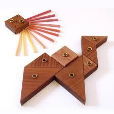 unique menorah tangram hanukkah menorah wooden modular chanukaih studio armadillo