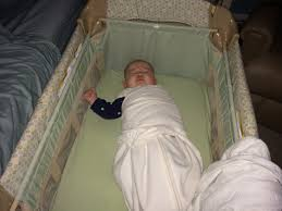 Baby Sleeping In A Crib by Best Baby Bassinets For Room Sharing And Breastfeeding
