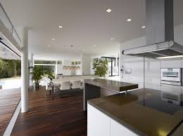 Contemporary Vs Modern Kitchen White Grey Kitchen Countertop Hanging Lamps Brown Wooden