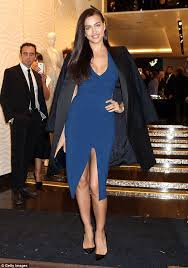 irina shayk wows in plunging deep blue gown and tuxedo jacket at