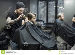 haircut of small boy in barbershop stock photo image 83485213