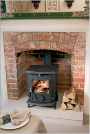 wondrous black wood burning fireplace design idea with brown brick