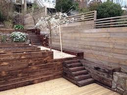 easy garden fence ideas reclaimed scaffold board fence an awkward heavily sloped garden
