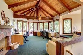 craftsman home office with vaulted ceiling u0026 flush light in