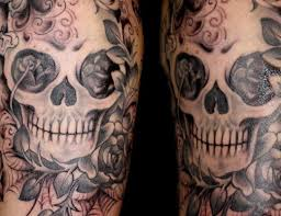 evil skull and flames tattoos on arm photos pictures and