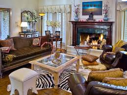 this eclectic living room centers around a zebra print rug it is