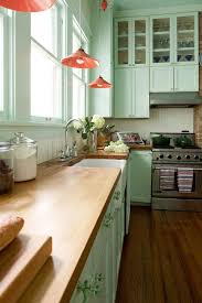 how to hang kitchen cabinets on brick wall mint green kitchen cabinet set wooden countertop white