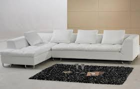 white leather sectional sofa with single armrest and tufted saddle
