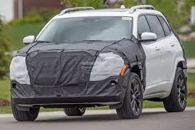 2018 jeep grand wagoneer spy photos 2018 jeep cherokee prototype hints at single unit headlights