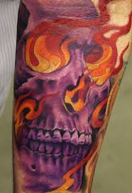 purple skull in flames tattoo by phil young tattoos