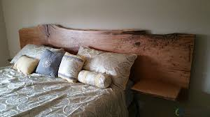 custom live edge white oak headboard with built in end tables by