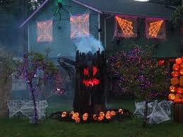 use lights to create a giant scary spider web halloween