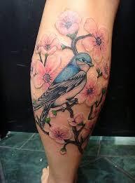 angry bird sitting on cherry blossom tree on back leg