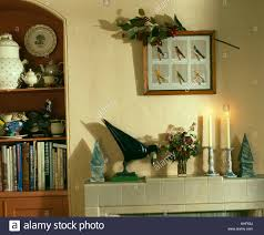 up of ornaments on mantelpiece in nineties living room stock
