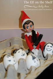 elf on the shelf ideas elf decorates the eggs