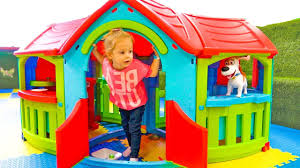 Kids Outdoor Entertainment - funny baby and toy max playing on the indoor playground