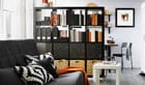 divide a room chicly with screens bookshelves or curtains the