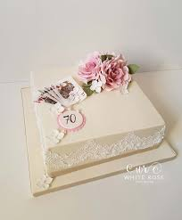 70th birthday cake for a bridge player by white rose cake design