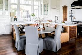 l shaped banquette behind l shaped island transitional kitchen