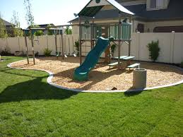 Big Backyard Landscaping Ideas with Outdoor A Slide And A Swing In The Back Yard And Then A White