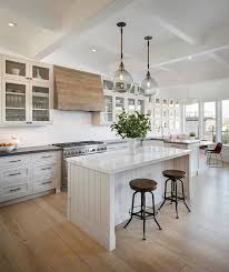Glass Doors For Kitchen Cabinets - gray glass door kitchen cabinets with white subway tiles