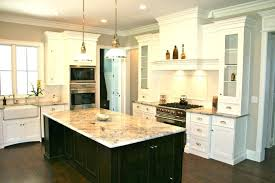 white kitchen island with granite top uk cabinets black off