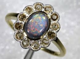 12 20cts solid opal diamond and gold art deco ring