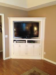 built in white corner media cabinet with shelves of delightful