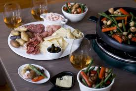 raclette cheese whole foods relishing raclette a pungent cheese finding its way into american