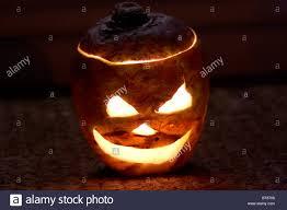 halloween pumpkin head jack lantern with burning candles over black background turnip lantern stock photos u0026 turnip lantern stock images alamy