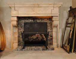 a large 17th c french limestone castle fireplace mantel piece