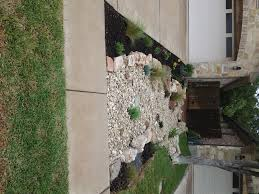 front yard landscape dry creek bed using really cool limestone