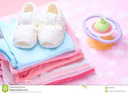 Cute Clothes For Babies Cute Baby Shoes For Kids On Pile Of Baby Clothes Stock Photo