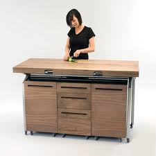 expandable kitchen island phil crook s workstation nests above your stovetop and sink before