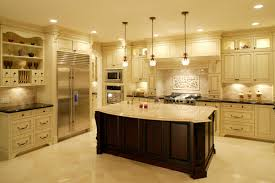 white luxury kitchen design with dark island and large refrigerator jpg