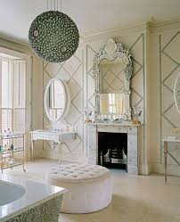 luxury bathroom with fireplace and venetian mirror elegant and