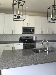 Herringbone Kitchen Backsplash Subway Tile Ballard Island Lights And New Caledonia Granite