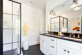 white and black bathroom with yellow accents transitional bathroom