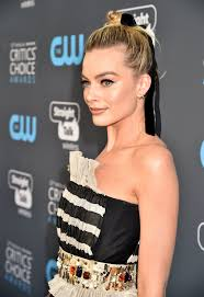 pictures of miss robbie many hairstyles margot robbie dominates with a pretty hair ribbon and top knot at