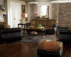 black and brown colour sofa on room wooden design table on living